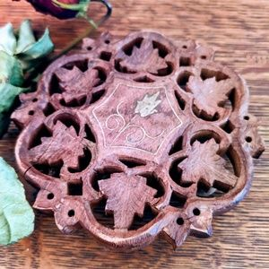 Carved wood Trivet with brass inlay, vintage